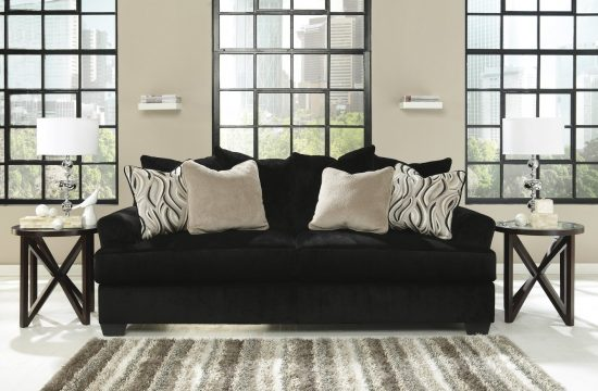 Add style and beauty to your living area with a black fabric sofa