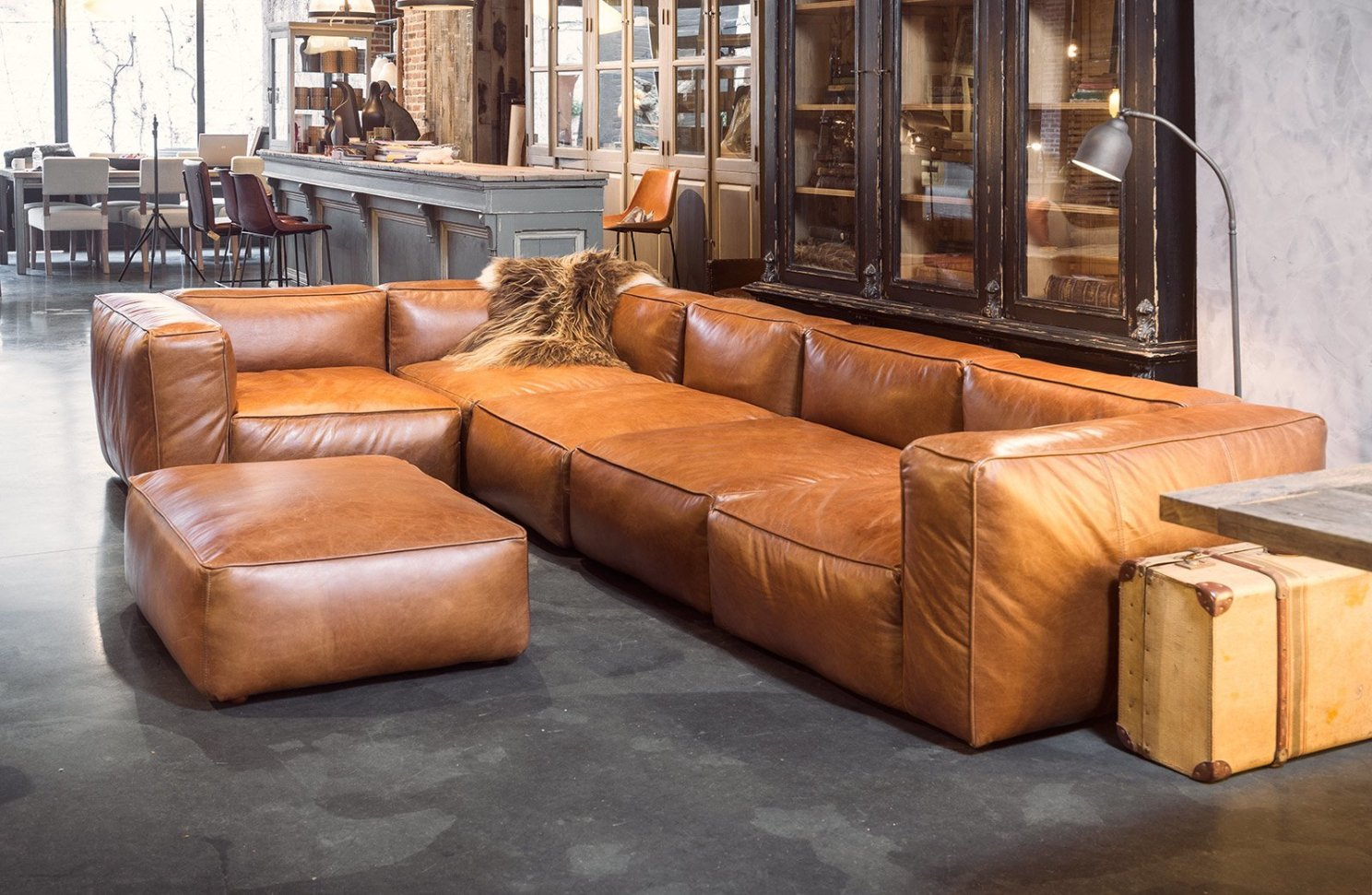 cognac leather sofas are now on trend for 2018 homes. Black Bedroom Furniture Sets. Home Design Ideas