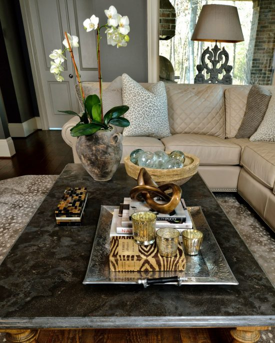 Add style to your coffee table décor to enhance the room beauty