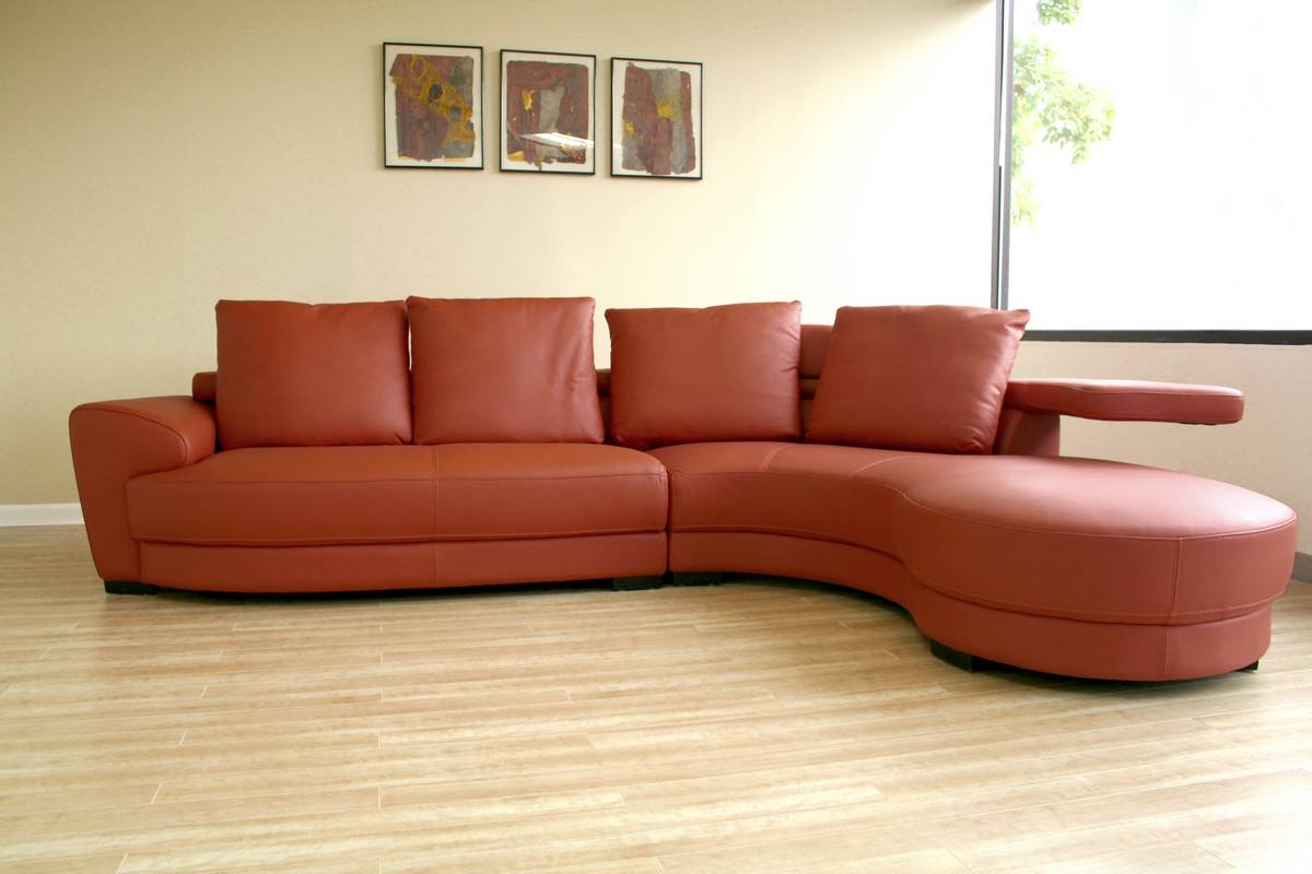 The incredible effect of a curved leather sofa upon your for Modern sofas for sale